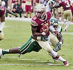 Florida State quarterback Everett Golson is sacked by South Florida's Mike Love in the first quarter of an NCAA college football game in Tallahassee, Fla., Saturday, Sept. 12, 2015. The FSU Seminoles defeated the South Florida Bulls 34-14.