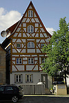 High gabled house with wooden decorative fascia. Altdorf, Nürnberg, Germany.