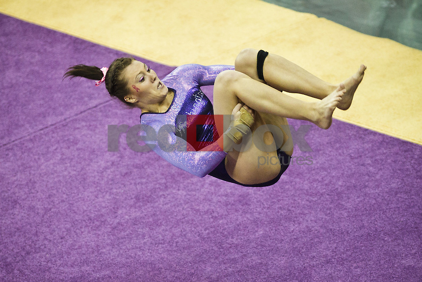 Amanda Cline..----Washington Huskies gymnastics tri-meet vs Louisiana State University and Seattle Pacific University at Alaska Airlines Arena at Hec Edmundson Pavilion in Seattle on Friday, February 17, 2012. (Photo by Dan DeLong/Red Box Pictures)