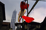 Laundry drying in an old quarter scheduled for demolition in Pudong District, close to China's tallest building, the 88-storey Jin Mao Tower..From China [sur]real © Mark Henley..