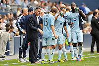 Peter Vermes Head Coach Sporting KC talks with his players during a stoppage in play..Sporting Kansas City defeated Chivas USA 4-0 at Sporting Park, Kansas City, Kansas.