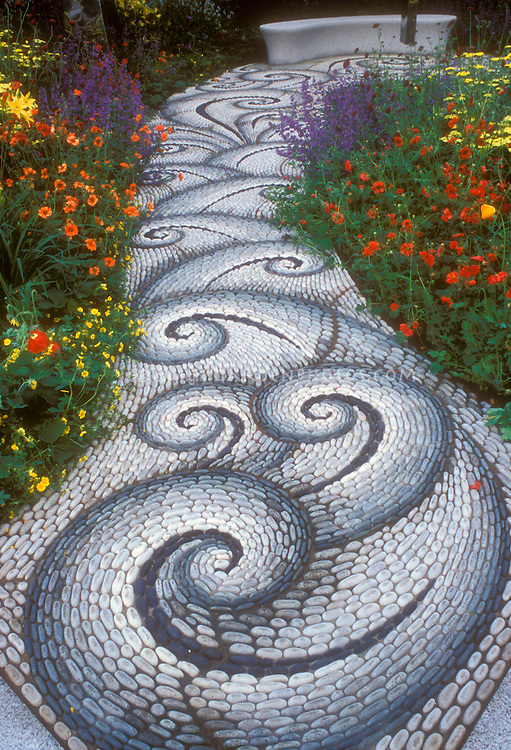 Swirling sinuous stone garden pathway Plant Flower