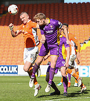 Blackpool's Tom Aldred competes in the air with Cheltenham Town's Kyle Storer<br /> <br /> Photographer Alex Dodd/CameraSport<br /> <br /> The EFL Sky Bet League Two - Blackpool v Cheltenham Town - Saturday 22nd April 2017 - Bloomfield Road - Blackpool<br /> <br /> World Copyright &copy; 2017 CameraSport. All rights reserved. 43 Linden Ave. Countesthorpe. Leicester. England. LE8 5PG - Tel: +44 (0) 116 277 4147 - admin@camerasport.com - www.camerasport.com