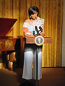 "Washington, D.C. - May 12, 2009 -- First Lady Michelle Obama  makes remarks as she and United States President Barack Obama host ""An Evening of Poetry, Music and the Spoken Word in the East Room of the White House in Washington, DC on Tuesday, May 12, 2009..Credit: Ron Sachs / Pool via CNP"