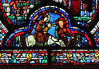 Virgin Mary carrying the baby Jesus whilst riding on a donkey to Bethlehem, from the St John the Evangelist stained glass window, 13th century, in the nave of Chartres cathedral, Eure-et-Loir, France. Chartres cathedral was built 1194-1250 and is a fine example of Gothic architecture. Most of its windows date from 1205-40 although a few earlier 12th century examples are also intact. It was declared a UNESCO World Heritage Site in 1979. Picture by Manuel Cohen