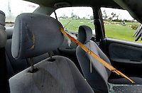 BLOUNTSTOWN, FL. 9/16/04-A chunk of wood is embedded in the headrest of a car Thursday near Blountstown. Late Wednesday night a tornado spawned by Hurricane Ivan swept through the neighborhood killing four people and destroying several homes. COLIN HACKLEY PHOTO