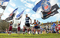 Francois Louw of Bath Rugby, mascot in hand, leads his team out onto the field. Aviva Premiership match, between Bath Rugby and London Irish on March 5, 2016 at the Recreation Ground in Bath, England. Photo by: Patrick Khachfe / Onside Images