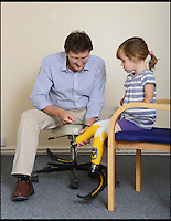 BNPS.co.uk (01202 558833)<br /> Pic: RachelAdams/BNPS<br /> <br /> Charlotte Nott (5) with senior prosthetist of Dorset Orthopaedic David Hills<br /> <br /> Determined Charlotte Nott has battled back from the brink of death in hospital three years ago to run for the first time on a new pair of prosthetic blades. Charlotte (5), from Oxford, lost all four limb to meningitis, and since then she has used rigid prosthetic legs which enable her to walk but has never been able to run around with her friends or younger brother. But she has now been donated custom made &pound;3,500 blade legs from specialists Dorset Orthopaedic in Ringwood, Dorset.