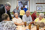 Agriculture Secretary Tom Vilsack, left, and Vice President Joe Biden talk with Sandra Axdale, Barb Baker, Kim Thompson, and.Char Thompson during an unannounced stop at the Good Earth Restaurant during a two-day campaign swing through Iowa on Monday, September 17, 2012 in Muscatine, IA.