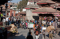 Kathmandu, Nepal.  Makhan Tole Street Scene, leading off of Durbar Square.  Men Carrying Goods.