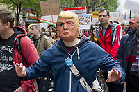 UNGARN, 22.04.2017, Budapest - VII. Bezirk. Die Spasspartei MKKP, &quot;Partei der doppelschwaenzigen Hunde&quot;, ruft zum Satire-Protest gegen die von der Fidesz-Regierung betriebene Putinisierung Ungarns. Es wird eine unerwartete Grossdemonstration mit tausenden Teilnehmern. Donald Trump mit CEU-Button. | The MKKP funparty &quot;Two-tailed dog party&quot; calls for satiric protest against the Fidesz government's putinization of Hungary. The event turns into a large demonstration with thousands of participants. -Donald Trump with pro-CEU button.<br /> &copy; Martin Fejer/EST&amp;OST