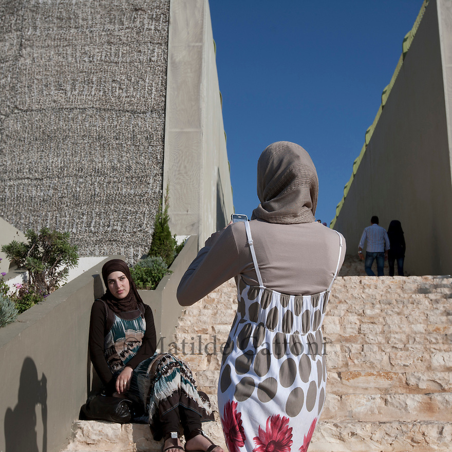 Lebanese ladies taking eachother pictures in Mleeta. Mleeta tourist landmark of the resistance in Lebanon is a natural museum, which inventively displays the Israeli spoils of war and the resistance weapons in open air on a land of 60,000 m2 of gardens and woods with 5,000 m2 of buildings.It is formed of several sections with outstanding architecture that combines the landmark with natural woods and a large cave. These sections vary from each other in order to portray the story of the resistance against the Israeli enemy in different shapes. The visitor will be aquatinted closely with the methods that the resistance employed to produce liberation in 2000 and victory in 2006.