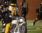 18 November 2006: The Wake Forest Demon Deacon mascot leads the players onto the field riding a motorcycle. The Virginia Tech Hokies defeated the Wake Forest University Demon Deacons 27-6 at Groves Stadium in Winston-Salem, North Carolina in an Atlantic Coast Conference NCAA Division I College Football game.