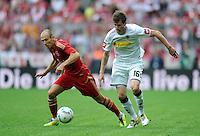 FUSSBALL   1. BUNDESLIGA  SAISON 2011/2012   1. Spieltag FC Bayern Muenchen - Borussia Moenchengladbach           07.08.2011 Arjen Robben (li, FC Bayern Muenchen) GEGEN Havard Nordtveit (re, Borussia Moenchengladbach)