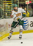 29 December 2014: University of Vermont Catamount Defenseman Alexx Privitera, a Junior from Old Tappan, NJ, in first period action against the Providence College Friars in the deciding game of the annual TD Bank-Sheraton Catamount Cup Tournament at Gutterson Fieldhouse in Burlington, Vermont. The Friars shut out the Catamounts 3-0 to win the 2014 Cup. Mandatory Credit: Ed Wolfstein Photo *** RAW (NEF) Image File Available ***