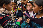 Young girls barter for sale of handcrafted embroidery at Cat Cat Village, Sa Pa, Hill town, Northern Vietnam