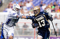 Justin Turri (12) of Duke defends Kelly McKenna (13) of Notre Dame during the NCAA Men's Lacrosse Championship held at M&T Stadium in Baltimore, MD.  Duke defeated Notre Dame, 6-5, to win the title in overtime.
