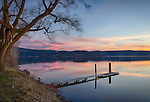 Idaho, North, Coeur d'Alene. A calm winter evening with cotton candy clouds reflecting in the waters of Lake Coeur d'Alene.