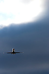 As storm clouds gather behind, a small commercial jet plane comes in for a landing at Chicago's O'Hare International Airport.