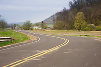 A road winds through a valley of Wisconsin's Driftless Area near Viroqua WIsconsin.