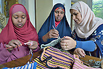 Refugee women in Cairo, Egypt, participate in a class on sewing and knitting provided by St. Andrew's Refugee Services, which is supported by Church World Service.