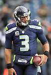 Seattle Seahawks  quarterback Russell Wilson (3) warms up beofre the game against the Cleveland Browns at CenturyLink Field in Seattle, Washington on December 20, 2015. The Seahawks clinched their fourth straight playoff berth in four seasons by beating the Browns 30-13.  ©2015. Jim Bryant Photo. All Rights Reserved.
