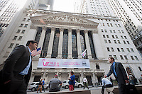 A banner for Vipshop decorates the front of the New York Stock Exchange in New York on Friday, March 23, 2012.  The Chinese online discount retailer, founded in 2008,  launched its IPO but raised less than its target amount. (© Richard B. Levine)