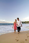 Couple on the beach at the Four Seasons Wailea, Maui, Hawaii
