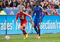 Toronto, Ontario - April 12, 2014: Colorado Rapids forward Edson Buddle #9 and Toronto FC defender Justin Morrow #2 in action during the 2nd half in a game between the Colorado Rapids and Toronto FC at BMO Field in Toronto.<br /> Colorado Rapids won 1-0.