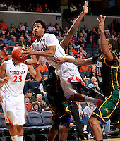 CHARLOTTESVILLE, VA- DECEMBER 6: Jontel Evans #1 of the Virginia Cavaliers shoots between Erik Copes #4 of the George Mason Patriots and Ryan Pearson #24 of the George Mason Patriots during the game on December 6, 2011 at the John Paul Jones Arena in Charlottesville, Virginia. Virginia defeated George Mason 68-48. (Photo by Andrew Shurtleff/Getty Images) *** Local Caption *** Jontel Evans;Erik Copes;Ryan Pearson