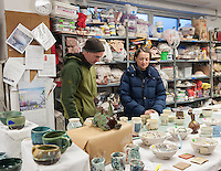 Members of a pottery studio in Chelsea in New York assist holiday shoppers at their annual ceramics sale on Saturday, December 10, 2016 (© Richard B. Levine)
