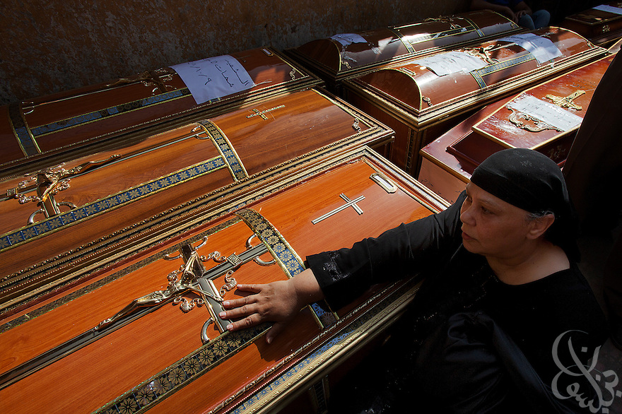 An Egyptian Coptic Christian woman mourns besides caskets for victims of sectarian violence October 10, 20011 at the Coptic Hospital in Cairo, Egypt. At least 26 people, mostly Christian, were killed during sectarian clashes that saw the worst violence since the Revolution that toppled former Egyptian president Hosni Mubarak earlier this year. Egyptian Coptic Christians make up about 10% of Egypt's 80 million population and periodically violence flares between the Christian minority and the majority Muslim population. (Photo by Scott Nelson)