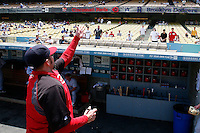 15 June 2011:  Reds pitcher #45 Bill Bray tosses a autogrpahed baseball to fans  before a Major League Baseball game LA Dodgers vs the Cincinnati Reds at Dodger Stadium during a day game. Players are wearing throwback uniforms from the 1940's. **Editorial Use Only**