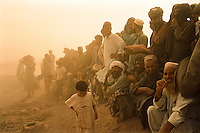 Blighted by war and famine, Afghan men with no jobs and no homes wait in the desert dust for anything that might improve their lives and the lives of their families. <br /> <br /> Afghan/Pakistan border