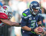 Seattle Seahawks quarterback Russell Wilson (3) scrambles against the Arizona Cardinals cornerback Patrick Peterson (21) at CenturyLink Field in Seattle, Washington on November 23, 2014. Wilson rushed for 73 yards, completed 17 of 22 passes for 211 yards and one touchdown in the Seahawks 19-3 win over the Cardinals.   ©2014. Jim Bryant Photo. All Rights Reserved.