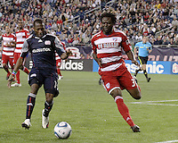 New England Revolution midfielder Sainey Nyassi (14) and FC Dallas defender Ugo Ihemelu(3) rush to retrieve a ball off a corner kick.  The New England Revolution drew FC Dallas 1-1, at Gillette Stadium on May 1, 2010