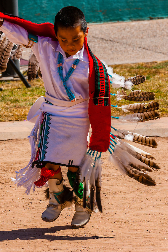 A 4 year old boy from the Oak Canyon Dance Group (Jemez Pueblo) performs the Eagle Dance,  Indian Pueblo Culture Center, Albuquerque, New Mexico USA