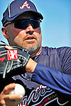 13 March 2012: Atlanta Braves Manager Fredi Gonzalez takes some warm-up tosses prior to a Spring Training game against the Miami Marlins at Roger Dean Stadium in Jupiter, Florida. The two teams battled to a 2-2 tie playing 10 innings of Grapefruit League action. Mandatory Credit: Ed Wolfstein Photo