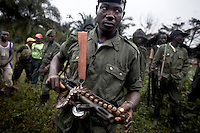 FDLR soldiers at a jungle camp on the North/South Kivu border, DRC. The FDLR comprises Hutu extremists who fled Rwanda after their involvement in the 1994 genocide, as well as Hutu members of the former Rwandan army and a mix of displaced Rwandan Hutus. Numbering approximately 10,000, they have lived in the jungles of DRC for the past 14 years and in that time have resisted repeated calls for disarmament and repatriation.