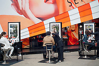 "A Sephora pop-up shop in the trendy Meatpacking District in New York is seen on Saturday, March 24, 2012. The store, a partnership with Sephora and Pantone promotes the ""Tangerine Tango"" line of products. The color is the official hue of 2012 chosen by Pantone based on their studies of color trends.  (© Richard B. Levine)"