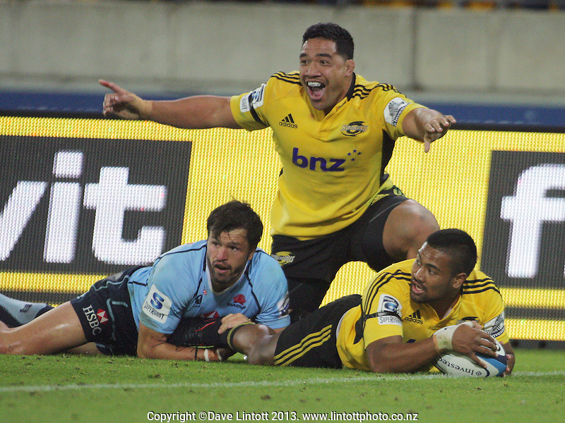 Motu Matu'u celebrates Julian Savea's try in the tackle of Adam Ashley-Cooper before play was pulled back for an earlier infringement during the Super Rugby match between the Hurricanes and Waratahs at Westpac Stadium, Wellington, New Zealand on Saturday, 6 April 2013. Photo: Dave Lintott / lintottphoto.co.nz
