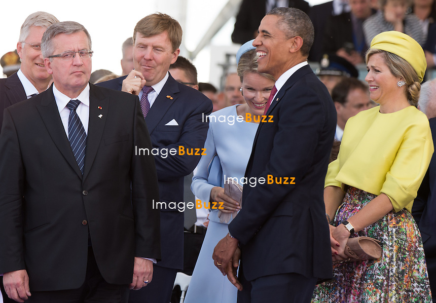KING PHILIPPE OF BELGIUM, BRONISLAW KOMOROWSKI, KING WILLEM-ALEXANDER, BARACK OBAMA, QUEEN MATHILDE OF BELGIUM, QUEEN MAXIMA OF THE NETHERLANDS - 70th Anniversary Of The Liberation - International Ceremony in Ouistreham, France. with Fran&ccedil;ois Hollande, President of the French Republic, Prime Minister, Barack Obama, Queen Elizabeth II, King Philippe of Belgium, Angela Merkel, Grand Duke of Luxembourg, Henri, King Willem-Alexander of the Netherlands, King Harald V of Norway, Vladimir Putin, Tony Abbott ; Prime Minister of Australia, Stephen Harper ; Prime Minister of Canada, Milos Zeman ; President of the Czech Republic, Queen of Danemark ; Margrethe II, Karolos Papoulias ; President of the Hellenic Republic, Giorgio Napolitano ; President of the Italian Republic, Jerry Mateparae ; Governor-General of New-Zealand, Bronislaw Komorowski ; President of the Republic of Poland, Ivan Gasparovic ; President of the Slovak Republic, Queen Mathilde of Belgium, Prince Albert II of Monaco, Prince Charles, Prince Philip, Camilla, Duchess of Cornwall, Herman Van Rompuy, Elio Di Rupo, Maria Teresa of Luxembourg, Queen Maxima of the Netherlands, David Cameron, Grand Duke Jean of Luxembourg, Erna Solberg, Prime Minister of Norway.<br /> France, Ouistreham, June 6, 2014.<br /> 70&egrave;me Anniversaire de la Lib&eacute;ration en Normandie - C&eacute;r&eacute;monie Internationale &agrave; Ouistreham, en pr&eacute;sence de Fran&ccedil;ois Hollande, Pr&eacute;sident de la R&eacute;publique fran&ccedil;aise, du Premier ministre et de tous les les chefs de d&eacute;l&eacute;gation.<br /> France, Ouistreham, 6 juin 2014.