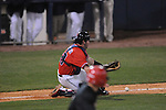 Ole Miss' Taylor Hightower (13) fielda a bunt at Oxford-University Stadium in Oxford, Miss. on Wednesday, March 2, 2010.