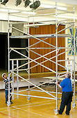 Premises Manager and Work Experience student moving a scaffolding tower,  State Secondary Roman Catholic school.