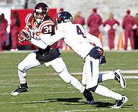 Nov 27, 2010; Charlottesville, VA, USA; Virginia Tech Hokies running back Ryan Williams (34) runs past Virginia Cavaliers safety Rodney McLeod (4) during the game at Lane Stadium. Virginia Tech won 37-7. Mandatory Credit: Andrew Shurtleff