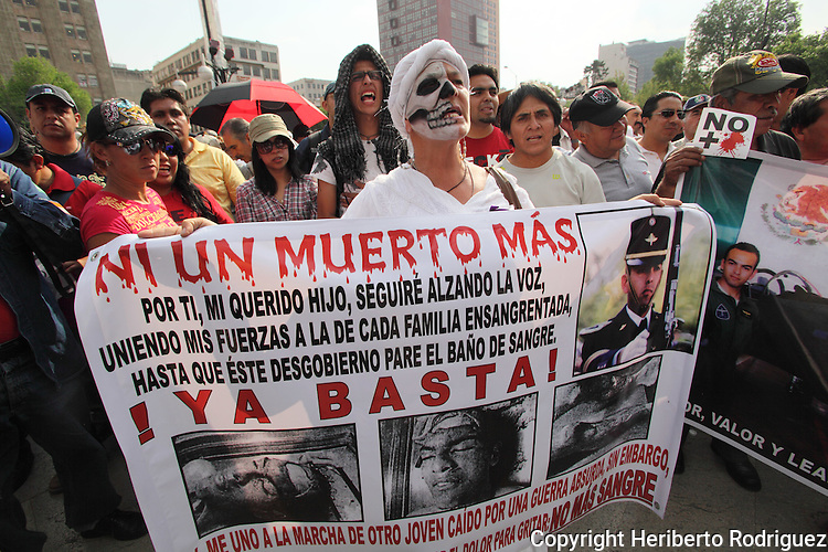 Mexican citizens stage a protest against the violence in Mexico as they arrive at the Mexico City's main plaza Zocalo, April 6, 2011. More than 30 thousand people have died since Mexican President started a so called War against drugs after taking office in 2006. Photo by Heriberto Rodriguez.