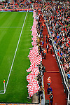 Stoke City 1 West Bromwich Albion 1, 24/09/2016. Bet365 Stadium, Premier League. Children waving red and white flags before kick off. Photo by Paul Thompson.