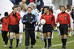 13 December 2009: Match officials. From left: Assistant Referee Andy Chapin, Alternate Official Lou Labbadia, Match Referee Chico Grajeda, and Assistant Referee Alex Gorin. The University of Akron Zips played the University of Virginia Cavaliers at WakeMed Soccer Stadium in Cary, North Carolina in the NCAA Division I Men's College Cup Championship game.