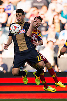 Leo Fernandes (22) of the Philadelphia Union and Sebastian Velasquez (26) of Real Salt Lake. Real Salt Lake and the Philadelphia Union played to a 2-2 tie during a Major League Soccer (MLS) match at PPL Park in Chester, PA, on April 12, 2014.
