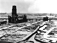 The German ultimatum ordering the Dutch commander of Rotterdam to cease fire was delivered to him at 10:30 a.m. on May 14, 1940.  At 1:22 p.m., German bombers set the whole inner city of Rotterdam ablaze, killing 30,000 of its inhabitants.  (OWI)<br /> NARA FILE #:  208-PR-10L-3<br /> WAR &amp; CONFLICT BOOK #:  1334